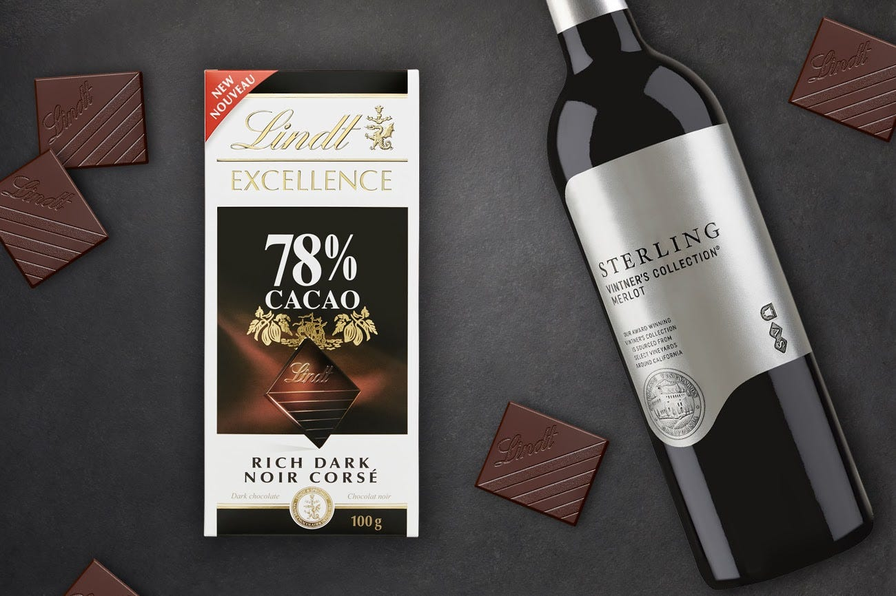 A bottle of Merlot and a package of Lindt Excellence 78% Cacao Rich Dark chocolate