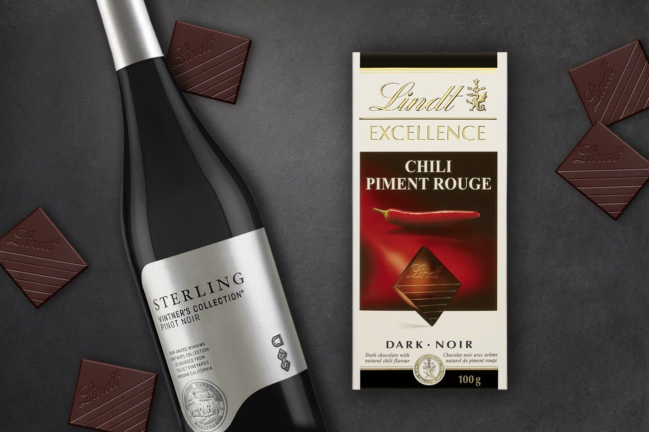 A bottle of Pinot Noir and a package of Lindt Excellence Chili Dark chocolate
